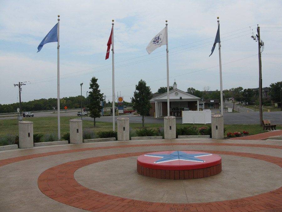 Here is a view of the Vietnam Veterans Memorial located in Monroe, Ohio. These flags are dedicated to the branches of the United States military and the local men who served in Vietnam.