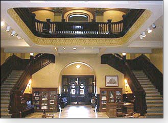 Here is  a view of the stunning view of the interior. There are double open stairways from the second floor to the third floor of the courthouse. There is a  cut-out ceiling exposing the top floor of the building.