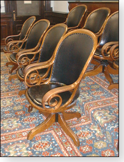The historic courtroom features jury chairs appropriate to the period of the courthouse.