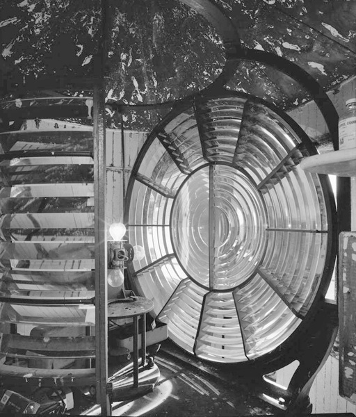 Interior view of watchroom with the fresnel lens and electrical lights visible