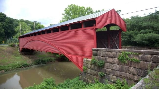 Built in 1853, the Barrackville Bridge is the second oldest surviving covered bridges in West Virginia, and one of only two remaining that was built by Lemuel Chenoweth. Image obtained from the Historical Marker Database.