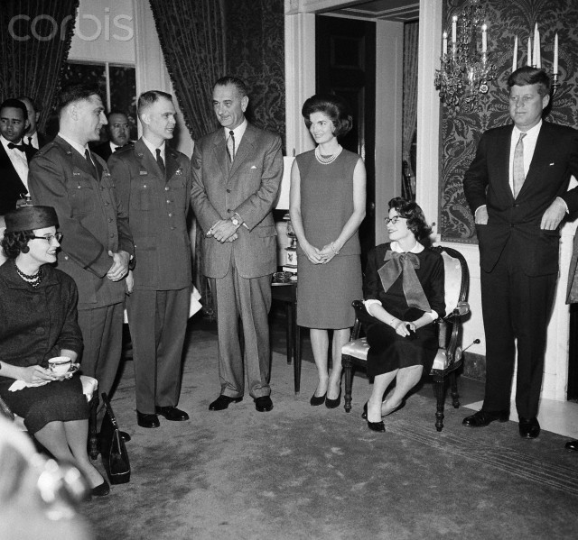 Captains John McKone, Bruce Olmstead, and their wives are honored at the White House with Vice President Lyndon B. Johnson, First Lady Jacqueline Kennedy, and President John F. Kennedy