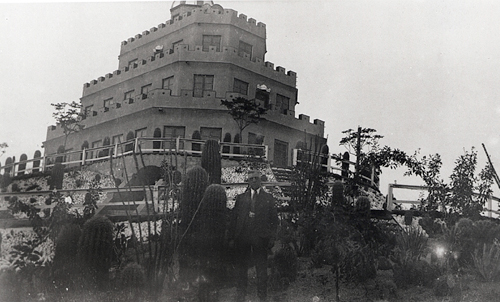 1930s photo of castle with Tovrea in front