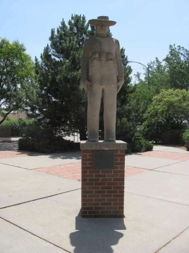 "The statue of James Butler ""Wild Bill"" Hickok stands on the corner of 10th and Main street in Hays, Kansas. Put up by Emprise Bank, it stands in the middle of Hays, giving itself a pertinent place in the view of the town."