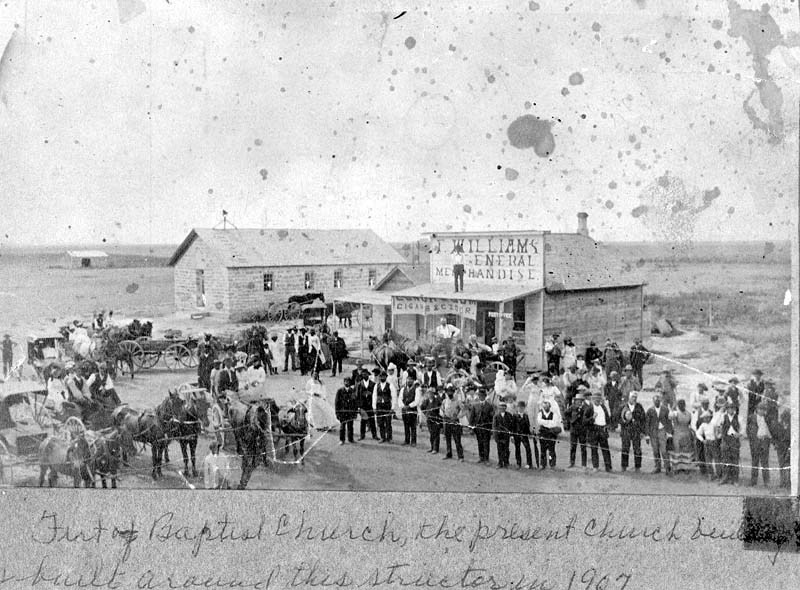 "African American community in Nicodemus, Kansas. These men, women, and children were part of Benjamin ""Pap"" Singleton's efforts to integrate freed men and ex-slaves into Kansas."