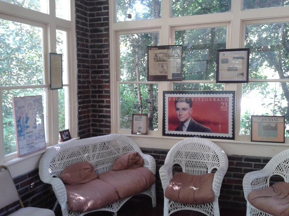 The sunroom of the Fitzgerald Museum, featuring some of the exhibits on display, including an enlarged stamp of Scott. Photo Courtesy: Gregory T. Janetka / Atlas Obscura