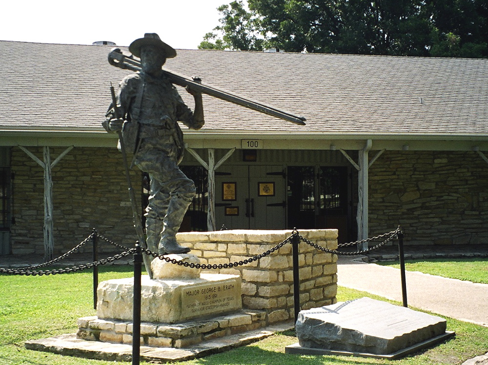Museum entrance. Statue features George Erath, Texas Ranger and surveyor of the Waco