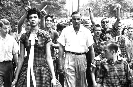 This photo of Dorothy Counts walking calmly while white parents harass her on her first day of school in 1957 demonstrated the sentiment that led to the closure of Harding High four years later.
