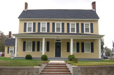 The Cook House was built circa 1900 and was donated to the society by Haroldine Cook Shaner.
