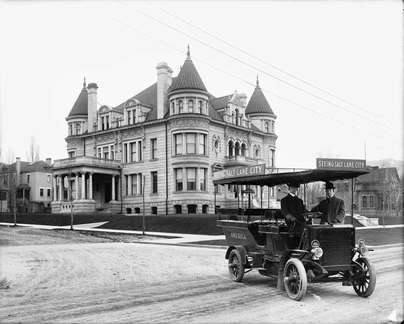Kearns Mansion shortly after it was constructed. Photo includes vehicle used for bus tours of Salt Lake City in the early 20th century.