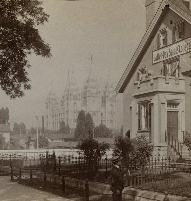 Lion House when it was being used by LDS University (Latter-Day Saints College). The Salt Lake Temple can be seen in the background because the Hotel Utah and Church Administration Building had not been built yet.