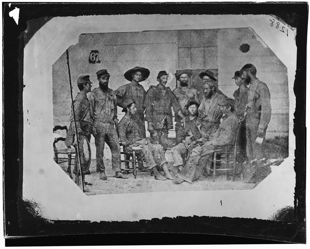 """""""19th-iowa-nco-prisoners"""" by Library of Congress - Library of Congress. Licensed under Public Domain via Wikimedia Commons - https://commons.wikimedia.org/wiki/File:19th-iowa-nco-prisoners.jpg#/media/File:19th-iowa-nco-prisoners.jpg"""