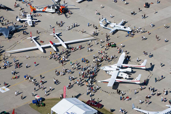Aerial view of some of the aircraft on display during an AirVenture gathering.