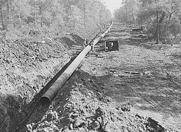 """""""Big Inch pipeline running through wooded land"""" by Vachon, John, 1914-1975."""