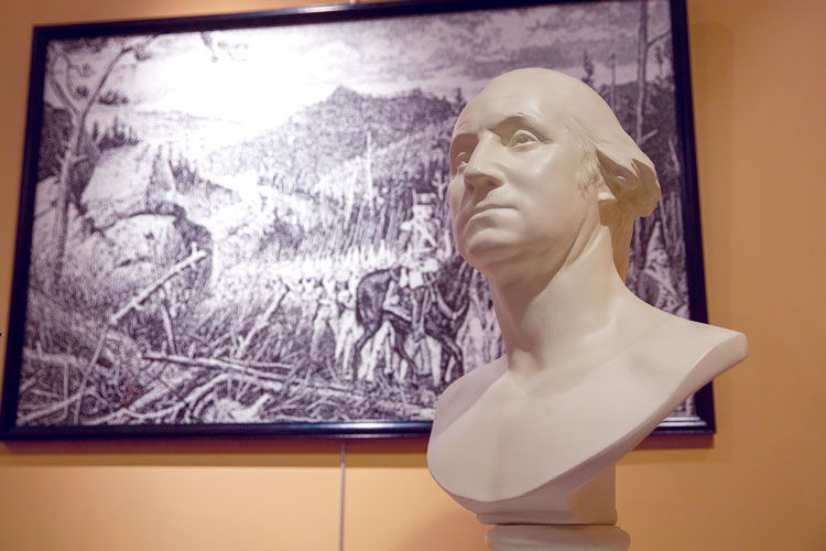 Bust of George Washington with artwork in the background. Washington gained valuable combat and leadership experience during the French and Indian War, which would serve him well leading the Continental Army twenty years later.
