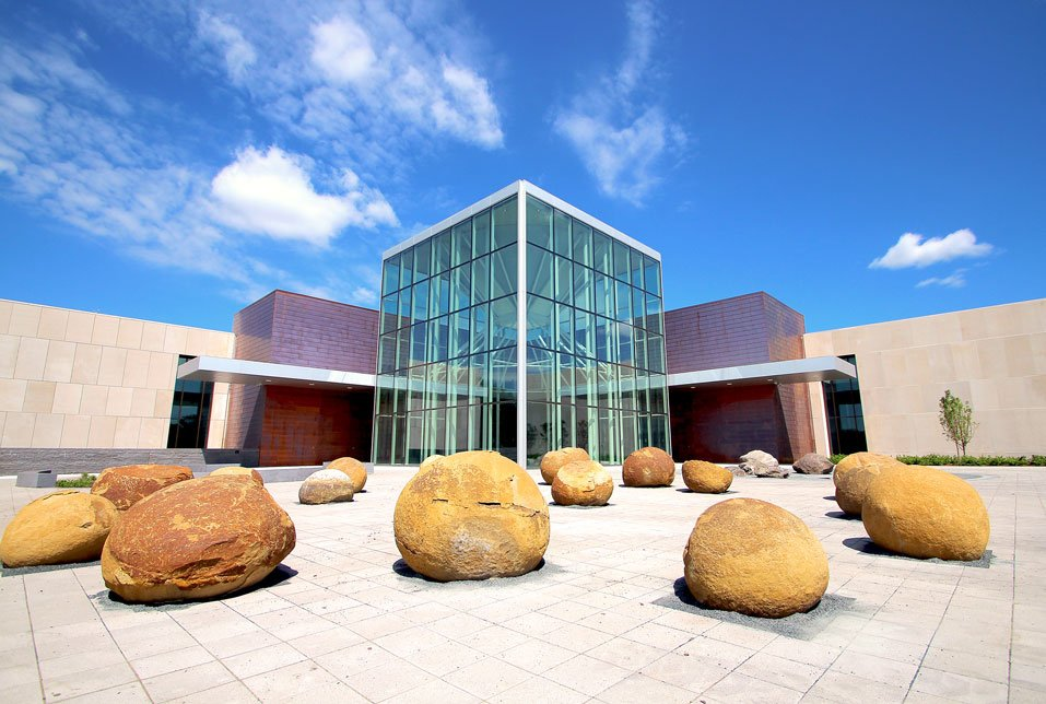 The North Dakota Heritage Center & State Museum is the state's main history museum. This photo shows the plaza in front of the new atrium. The large boulders in the foreground are 56 million years old.