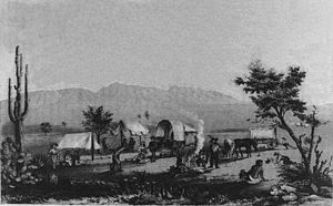 1857 of wagons stopping at Maricopa Wells, modern day Maricopa. Mountains in the background is where the battle was fought.