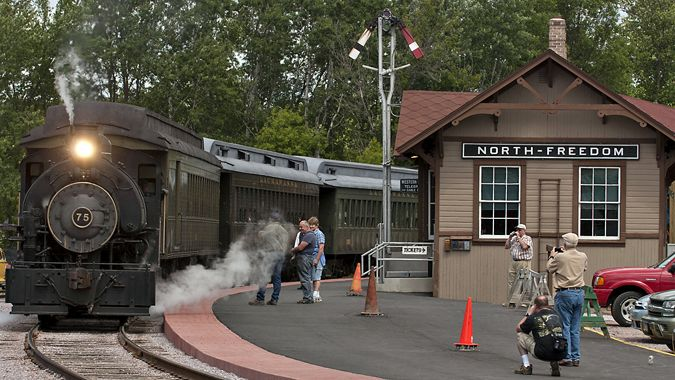 One of the locomotives rides past visitors at the Mid-Continent Railway Museum