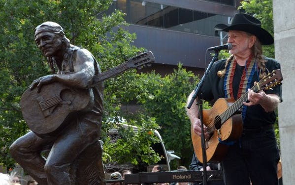 Willie Nelson performed at the unveiling of his statue, which is located in front of the theater