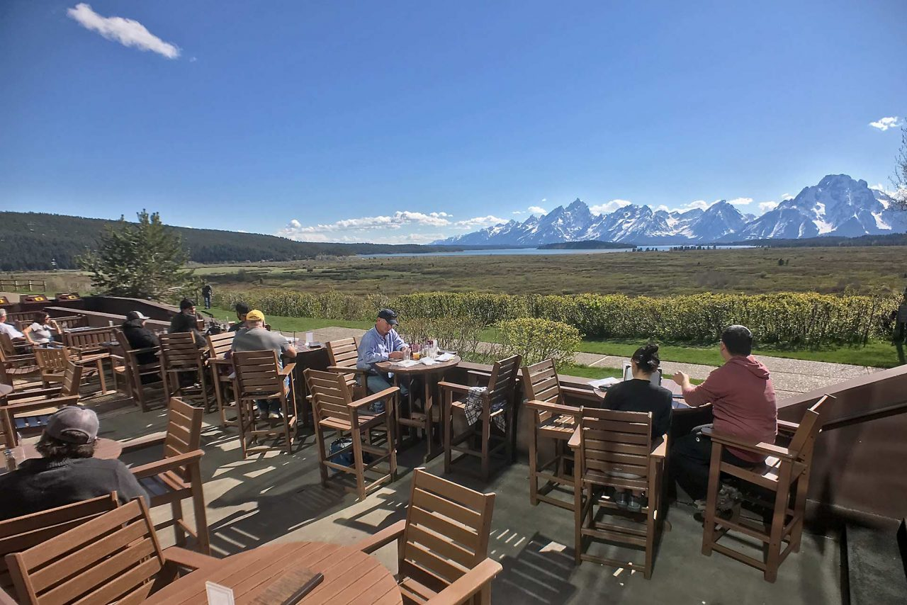Patrons enjoy the stunning vista from the lodge's rear patio.