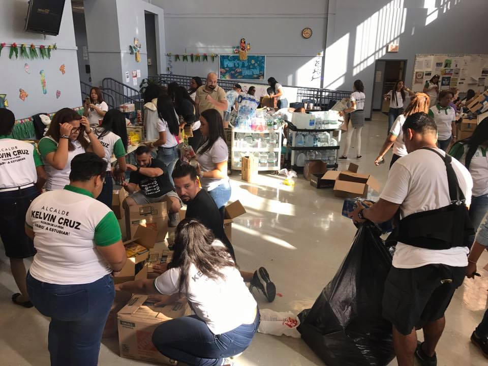 "Students helping to pack goods that were donated by community members in the ""United for Puerto Rico"" donation drive after Hurricane Maria."