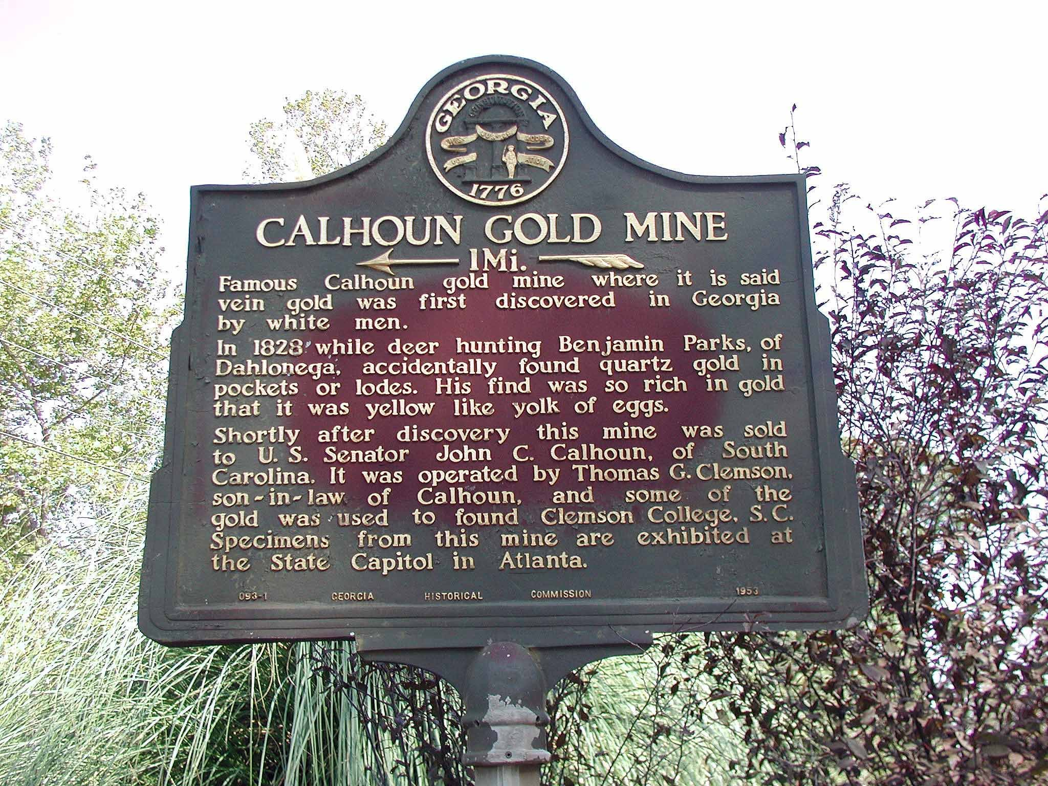 The historical marker for the Calhoun Gold Mine is located a mile from the former mine at the intersection of Calhoun Mine Road and the highway.