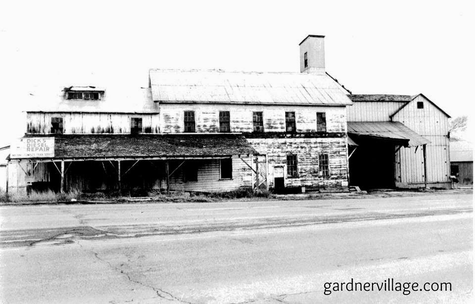 early-mid 20th century photo of mill after years of abandonment before becoming a shopping center.