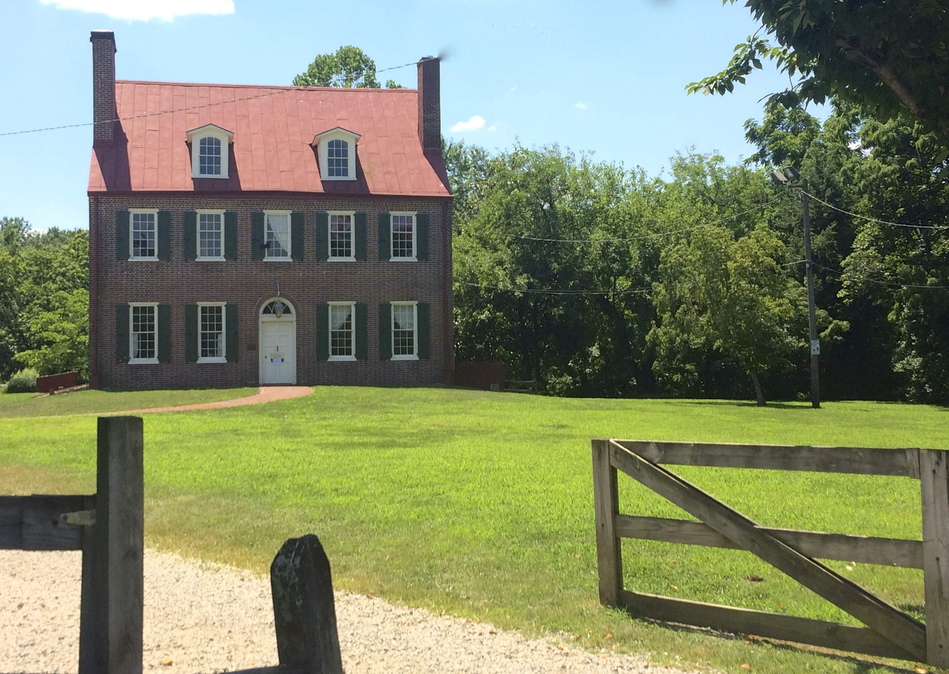 The Federal style Barclay Farmhouse sits within a 32-acre living history museum.
