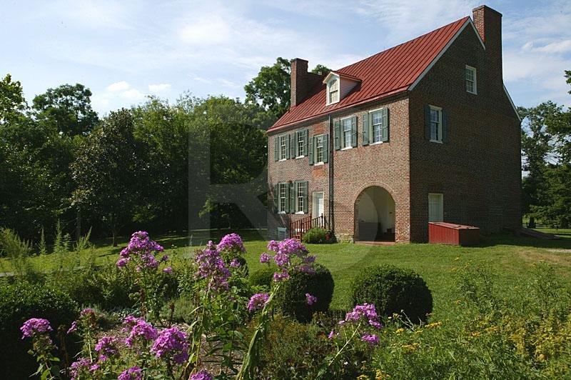 Flowers bloom behind the Barclay Farmhouse.