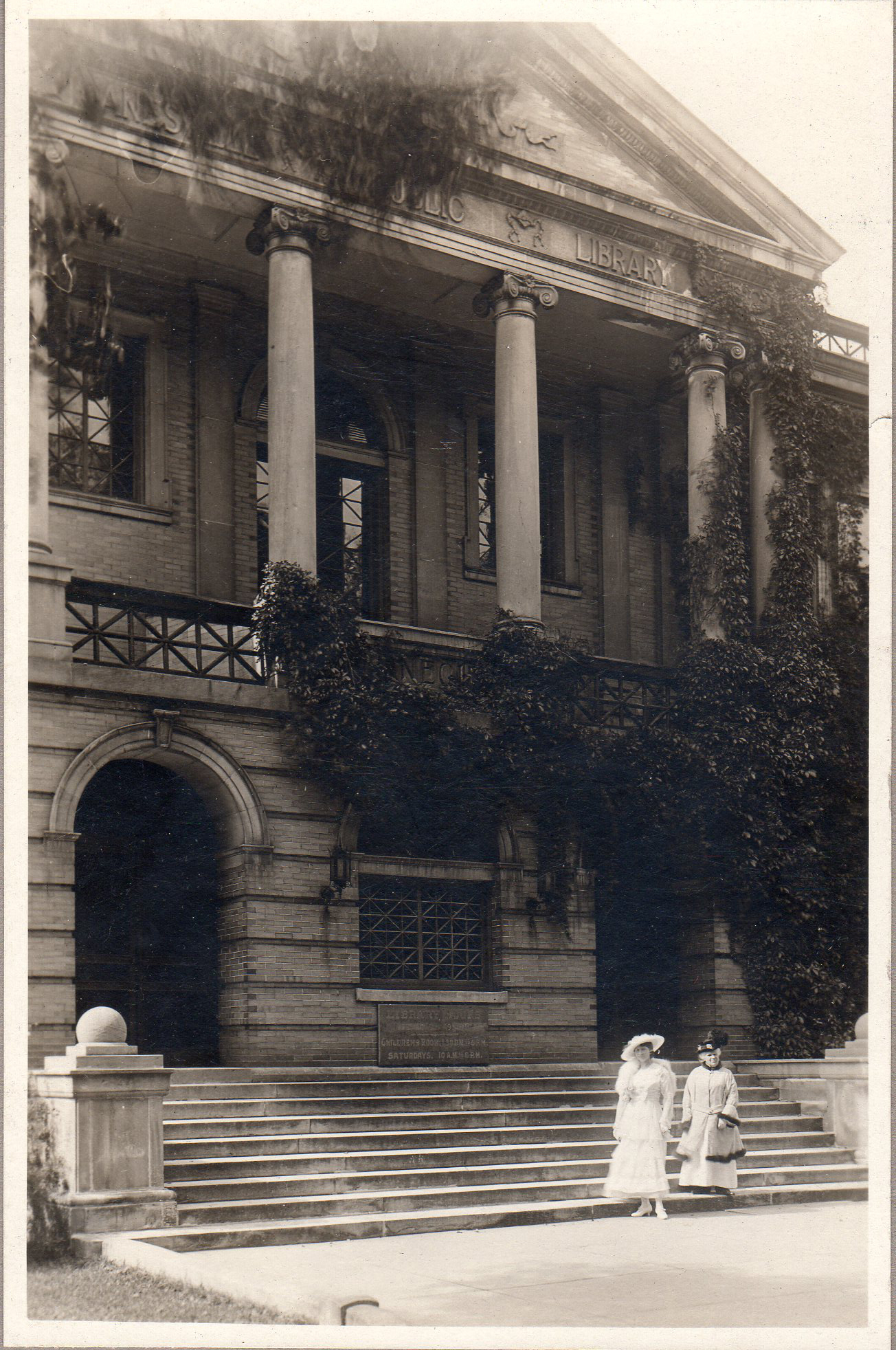Two women in front of the library at the turn of the century