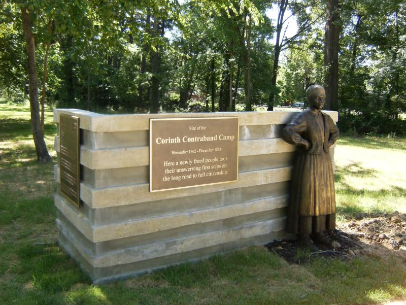 This statue depicting a woman leaning on the monument is one of several large statues at the historic camp.
