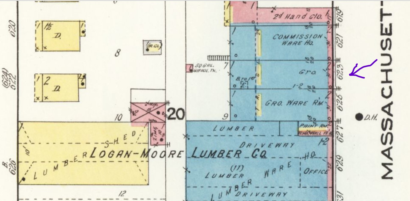 Previous building at 623 Mass. St. (arrow; stone with brick front facade) in 1918 (Sanborn Map Company 1918 p. 2)