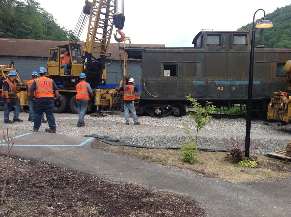 Delivery of the caboose. Restoration currently in progress.