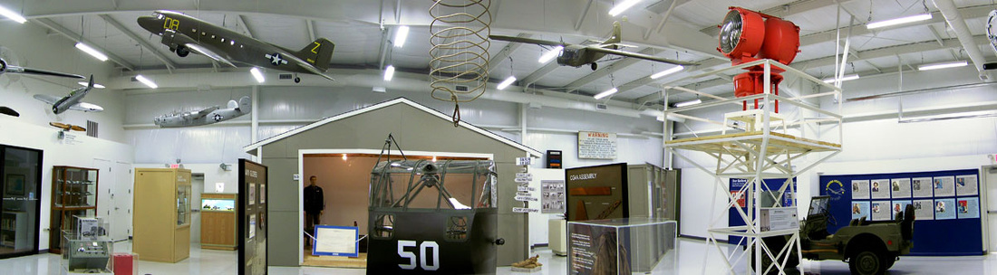 Interior view showing some of the scale model aircraft and the rotating beacon light on the right.