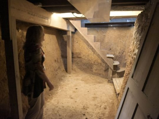 The basement space/root cellar located under the house's kitchen that was used to hide runaway slaves.