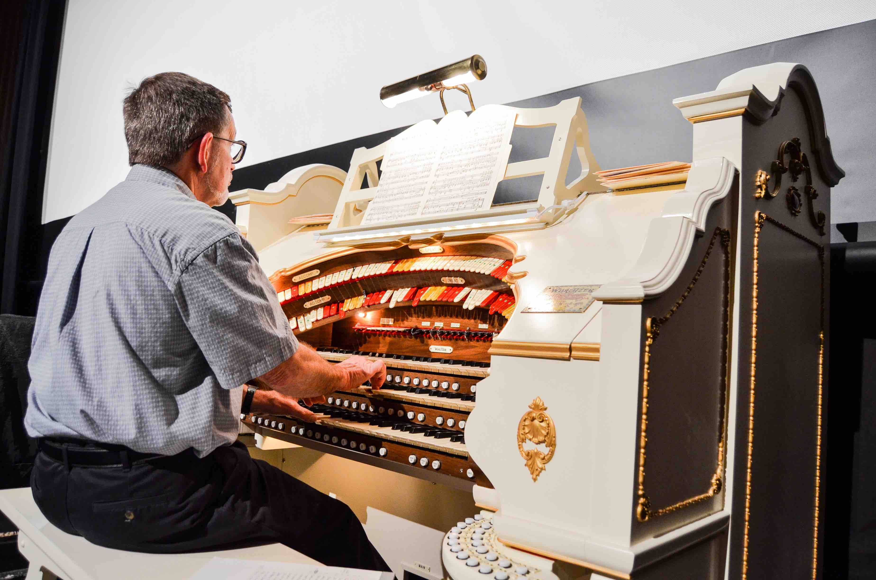 The organist plays the Appell's fully restored 1927 Mighty Wurlitzer.