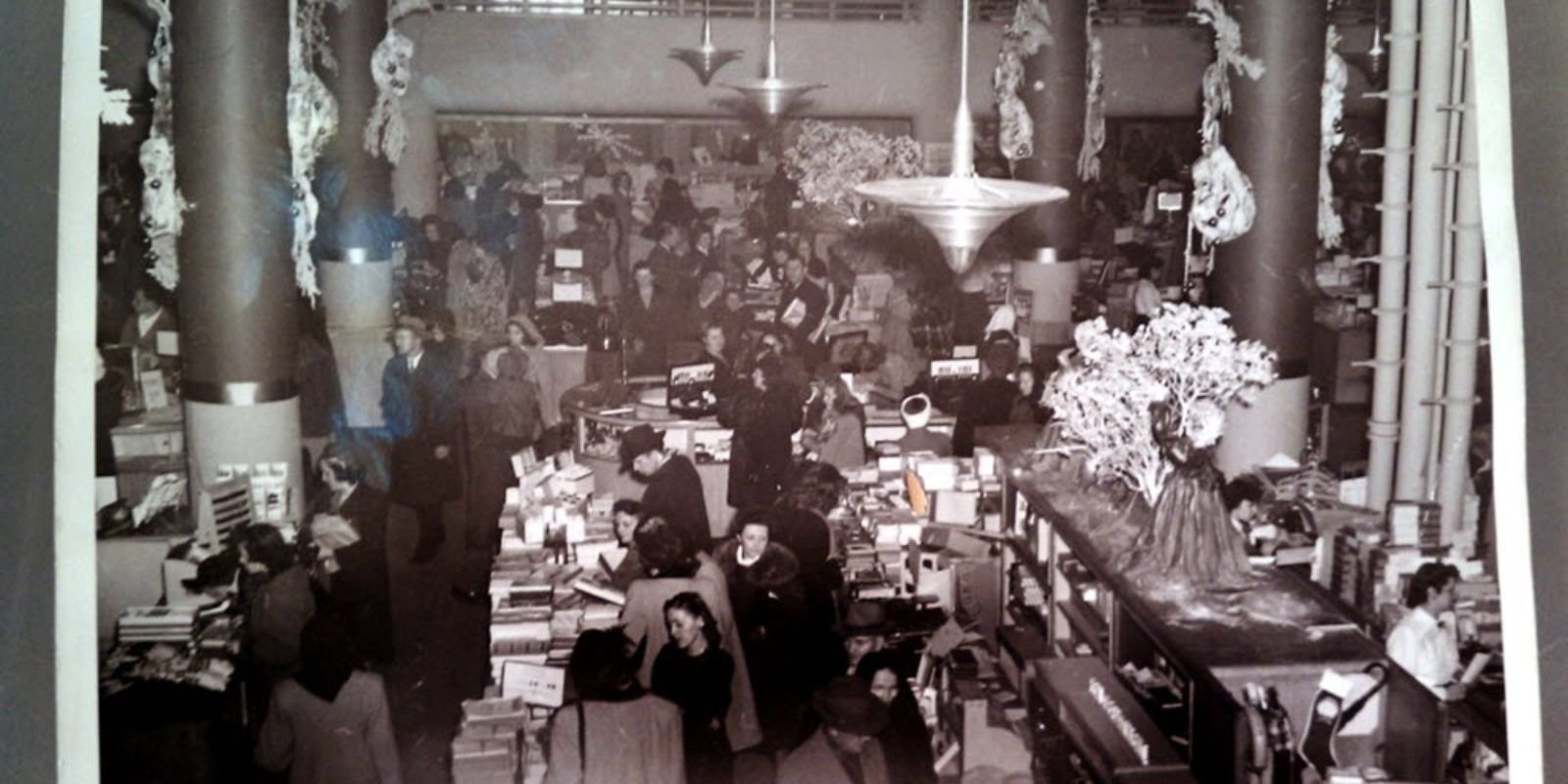 Shoppers making their purchases at the Bon-Ton in early times.