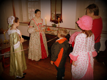Scene of tour in Manor taking place in the children's bedchamber
