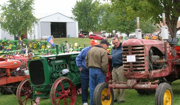 Visitors look at an old tractor at during one of the museum's annual Steam Show and Fall Festival Days.