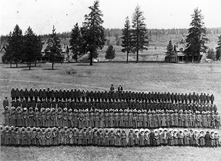 Native American students who attended the Indian school, lined up in military ranks.