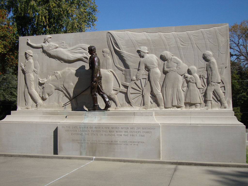 The memorial, with Lincoln standing in front of the relief.