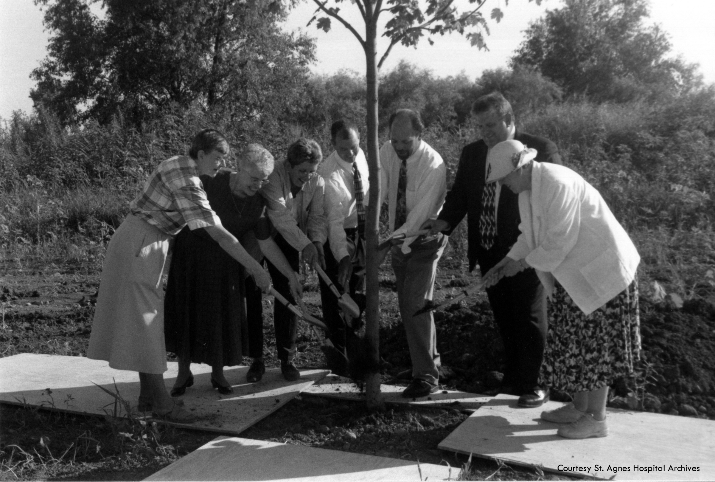 Tree planting at Hospice Home of Hope celebrating 120 years of Agnesian Healthcare, 2006.  Left:  Sisters Anne Jude Van Lanen and Mary Mollison; far right: Sister Mary Agreda Touchette.