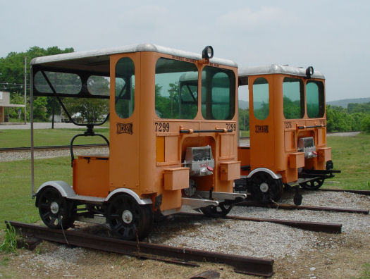 """The """"put-putt"""" cars, which repairmen used to travel down a track"""