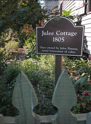 A sign marker indicating Julee's Cottage.