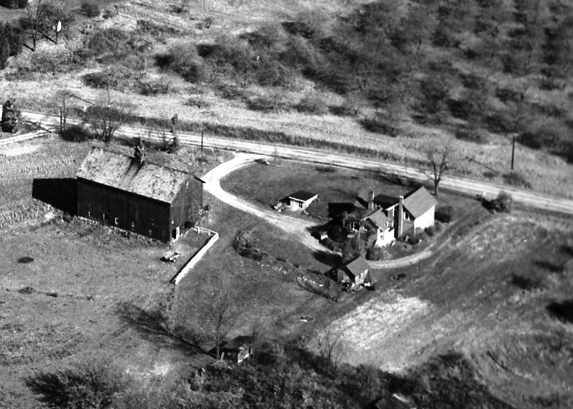 Aerial view of the farm circa 1956. Note the apple orchard across the road from the farm. The orchard was a part of Quick farm.