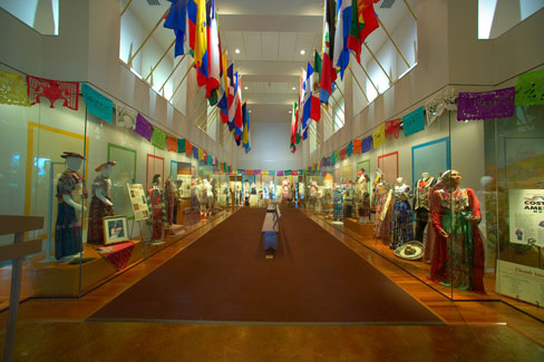 The entrance to the Costumes of the Americas Museum displays the flags of  the many nations represented by its vast collection of clothing, shoes, jewelry, and accessories.
