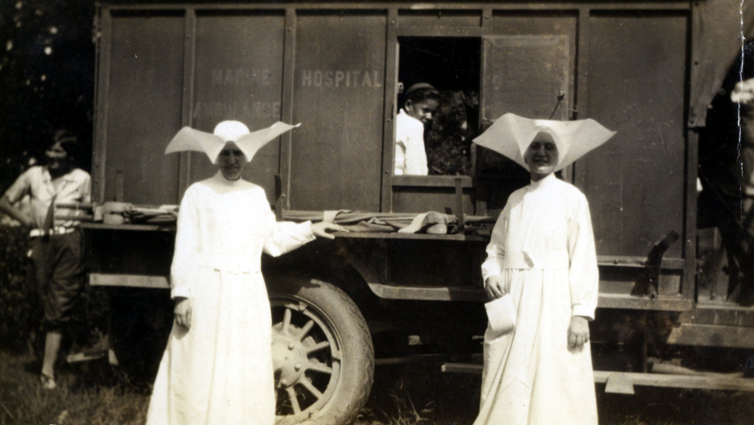 The Daughters of Charity, the first nurses at the hospital, arrived to care for the patients in 1896. Here they are pictured with two young patients. Photo 1930s.