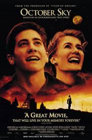 "The movie poster for ""October Sky"" to the right is Laura Dern who plays Miss Freida J. Riley. To the left is Jake Gyllenhaal who plays Homer Hickam."