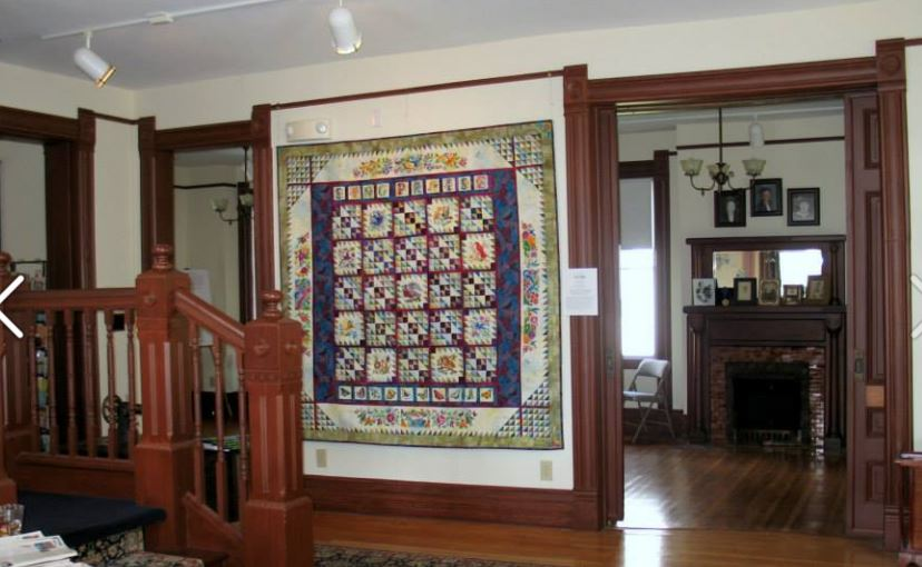 Quilts on display in the house.
