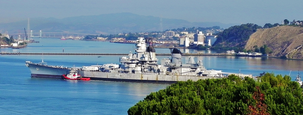 USS Iowa passes former Mare Island Naval Shipyard and the city of Vallejo as it is towed to a new berth as a museum ship in Los Angeles in 2012.